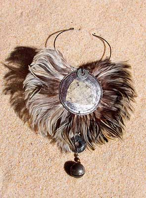 Bib feather necklace with an african bronze  bell