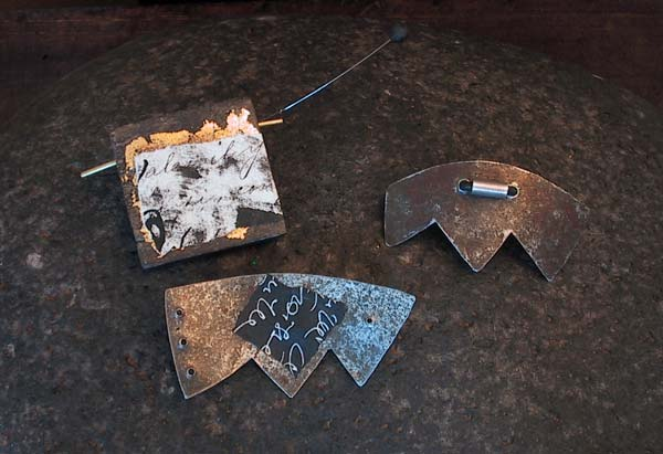 Contemporary brooches: oxidized and recycled metal