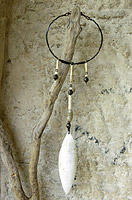 Necklace: long pendant made of horn, ethnics beads( old agate, indian and african beads, ostrich eggshells and bone), hammered iron and leather