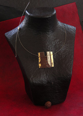 oxidysed metal necklace patinated with gold leaf