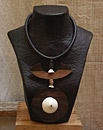 Necklace with Macassar ebony and ethnic beads and Mauritanian shell