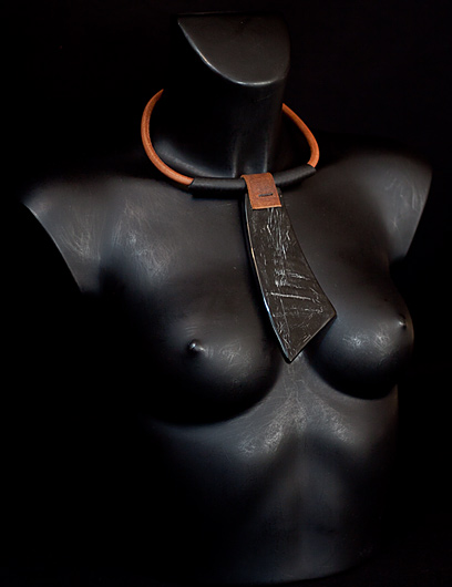 Ethnic style necklace:  leather  and polished buffalo horn