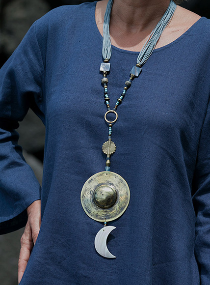Blue and golden hues for this mother of pearl talisman. Softly polished hand hammered brass disc.