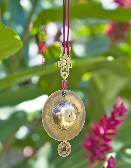 Oriental jewelry: Golden brass pendant with colored glass bead
