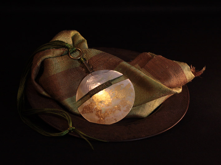 Mother of pearl pendant necklace patinated with gold leaf