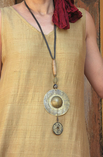 Ethnic necklace: Asian style hammered brass pendant