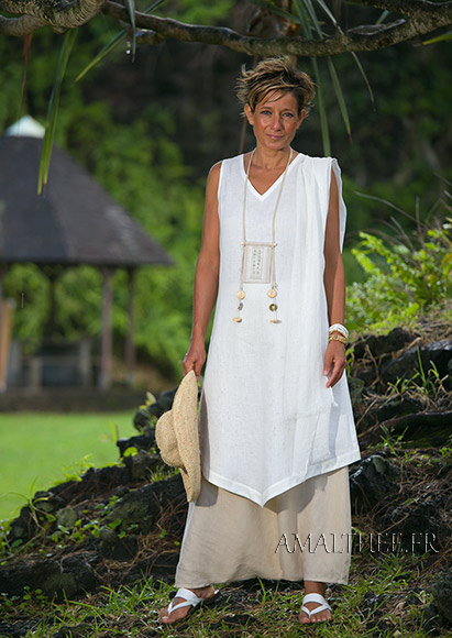 white linen sleeveless summer tunic and beige sarouel skirt