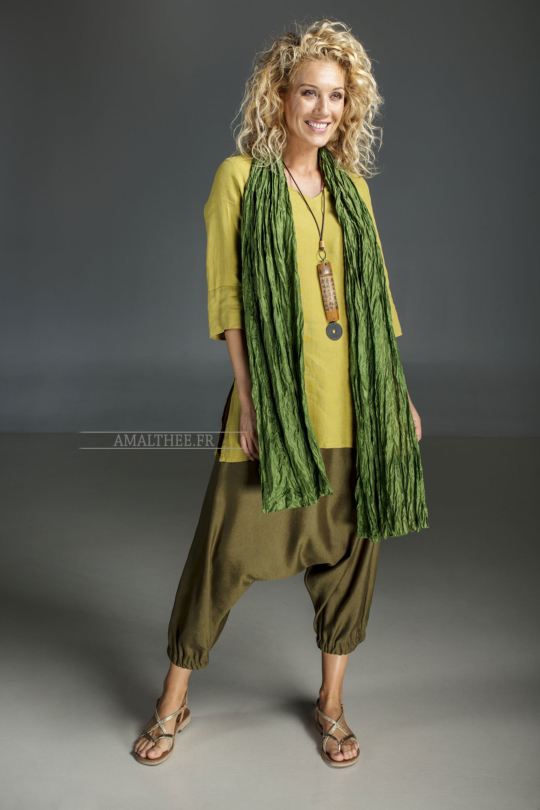 Linden green flax linen INDIE Tunic worn over a green  mixed linen sarouel skirt.and a green silk scarve. [category]